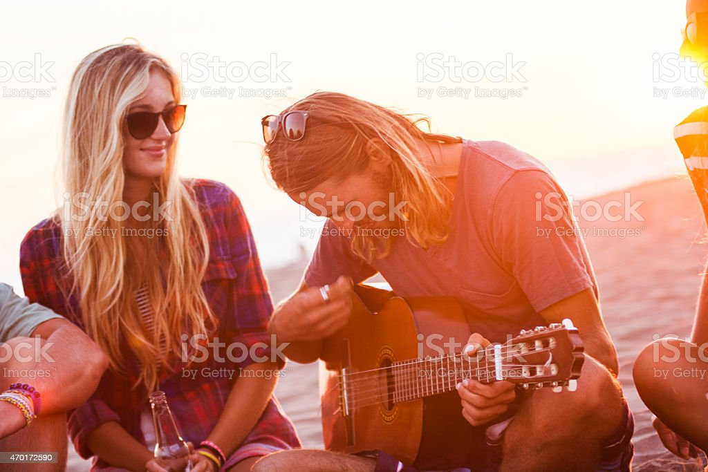 Playing guitar with friends stock photo