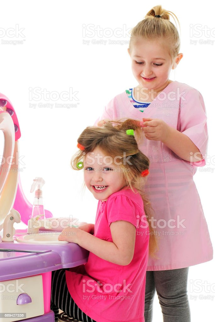 Playing Hairdresser stock photo