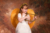 Little Angel playing her harp. Please view all images from this series along with other images relating to