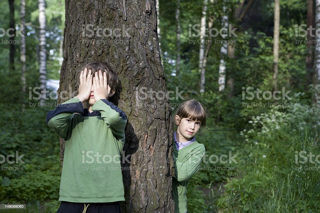 Playing hide-and-seek royalty-free stock photo