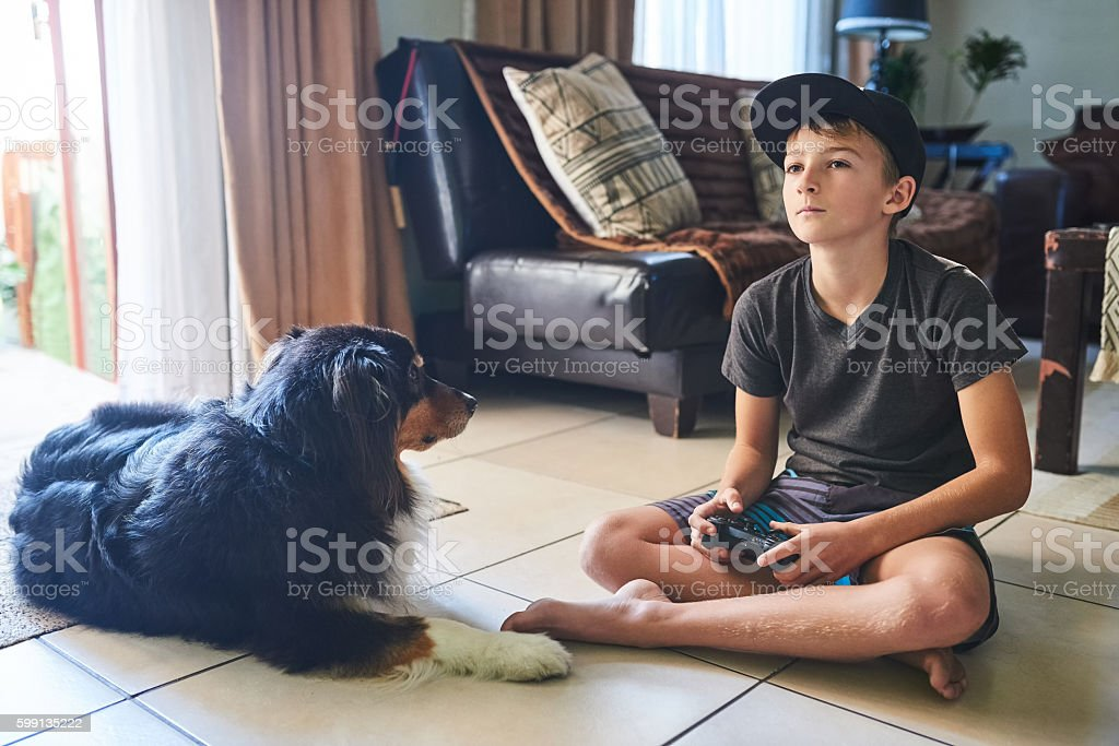 Playing his favourite video game stock photo