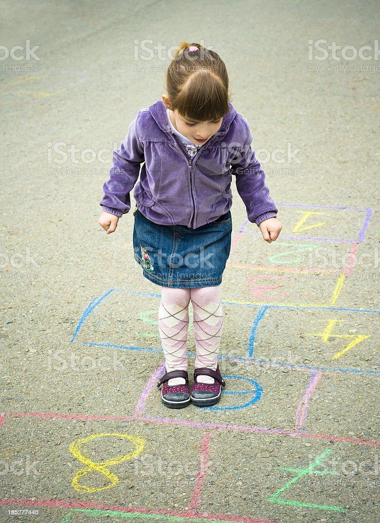 Playing hopscotch stock photo