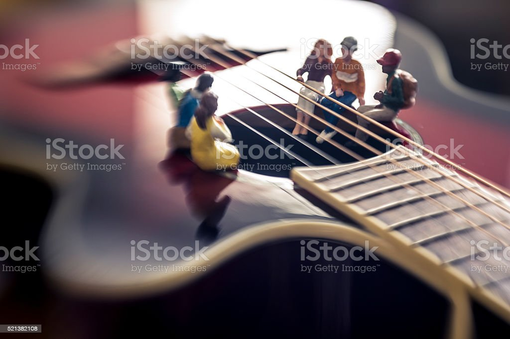 playing huge guitar stock photo