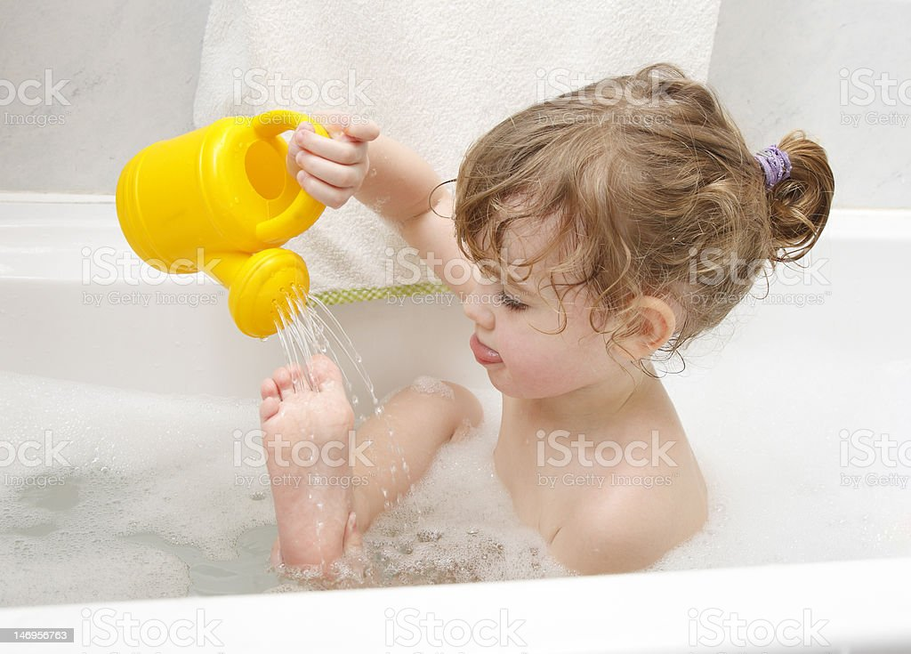 Playing in a bath stock photo
