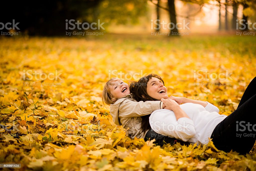 Playing in autumn time stock photo