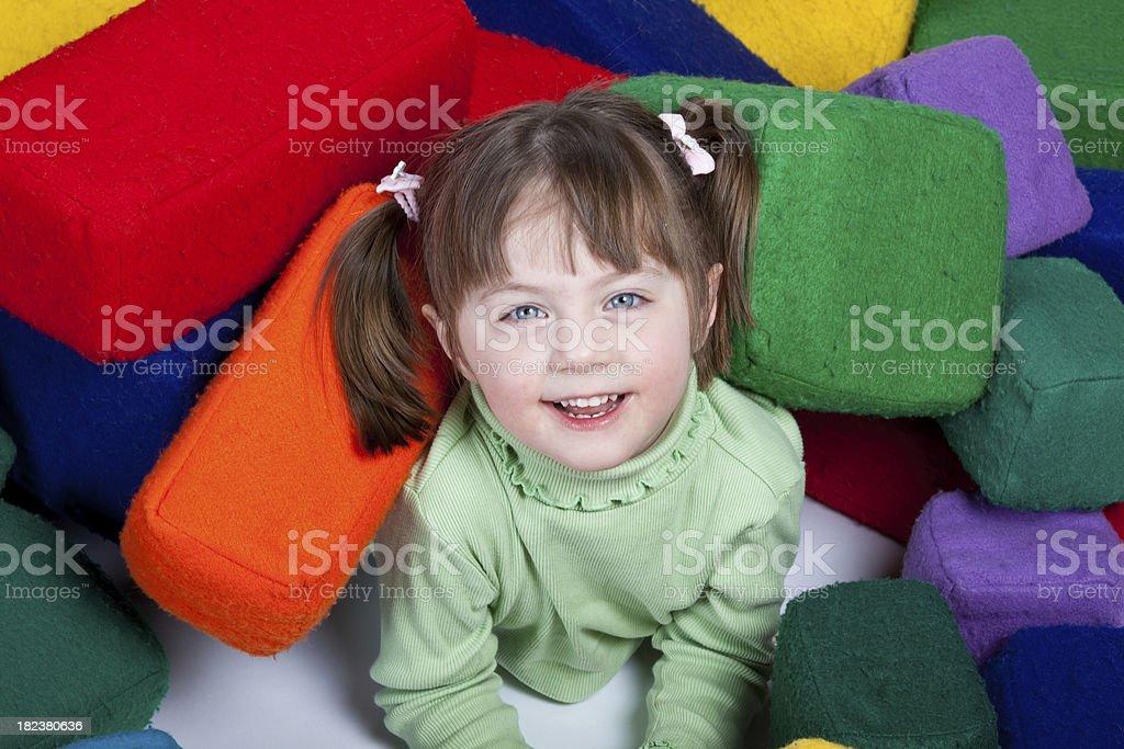 Playing in large foam blocks royalty-free stock photo