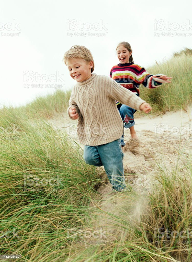 Playing in the dunes stock photo
