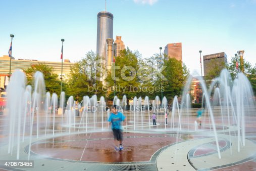 Atlanta, USA - April 16, 2013: Children playing at Centennial Olympic Park in the evening .