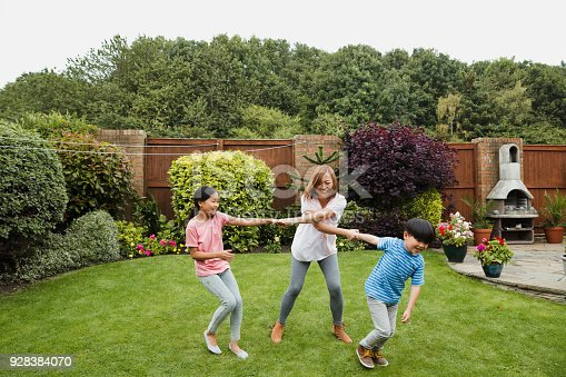 172407626 istock photo Playing in the Garden with Mum 928384070