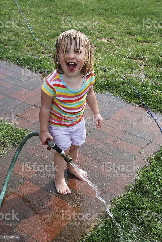 Playing in the Hose royalty-free stock photo