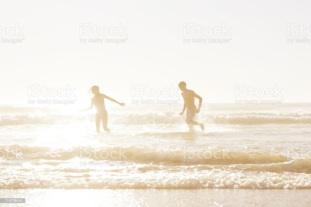 Playing in the ocean royalty-free stock photo