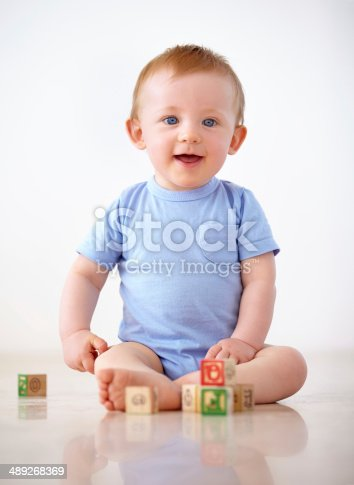489225417istockphoto Playing in the safety of home 489268369