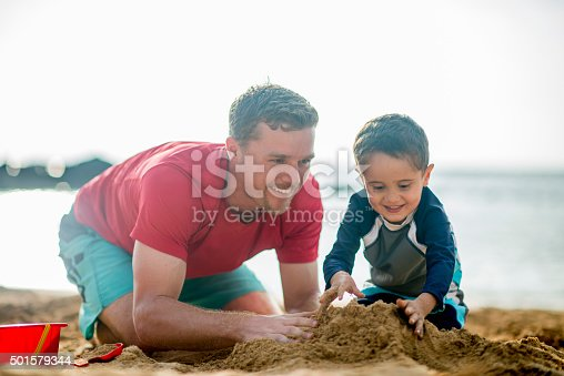 605742160 istock photo Playing in the Sand Together at the Beach 501579344