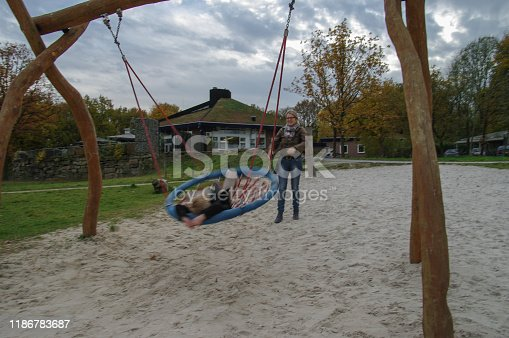 515278306 istock photo Playing in the swing set 1186783687