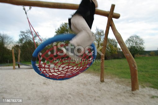 515278306 istock photo Playing in the swing set 1186783706
