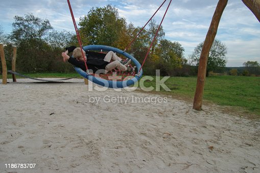 515278306 istock photo Playing in the swing set 1186783707