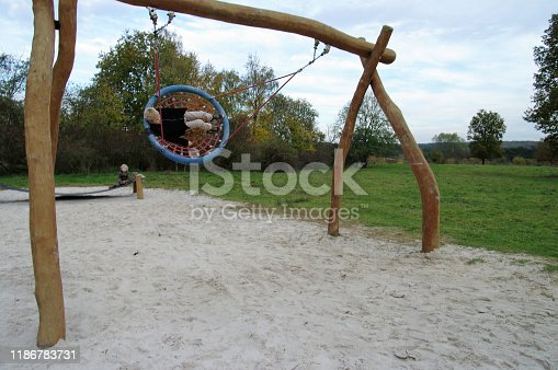 515278306 istock photo Playing in the swing set 1186783731
