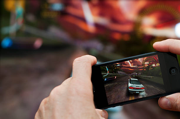 Playing iPhone 5 game on big screen via Apple TV stock photo