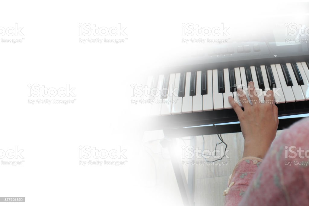 playing keyboard of the piano foreground stock photo