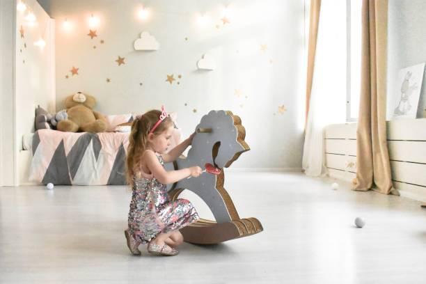 playing little girls kids - unicorn bed imagens e fotografias de stock