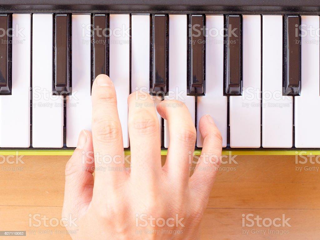 Playing mini digital piano, Dm stock photo
