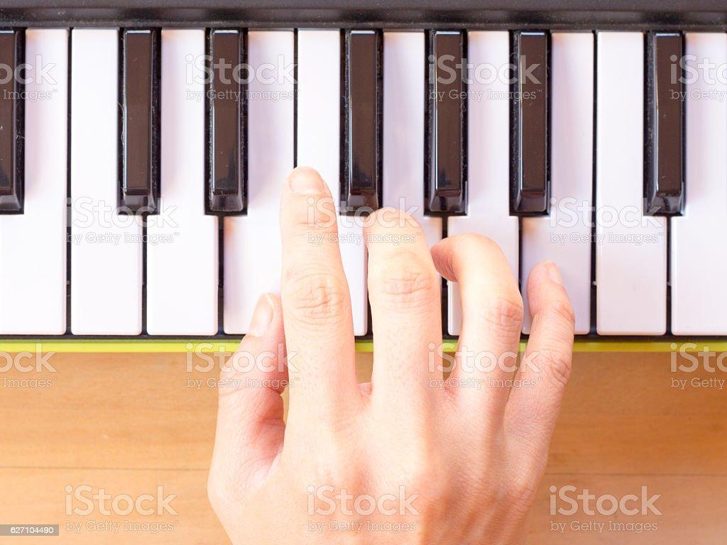 Playing mini digital piano, Em stock photo