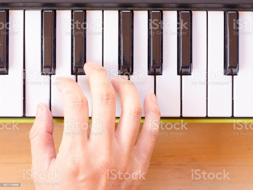 Playing mini digital piano stock photo