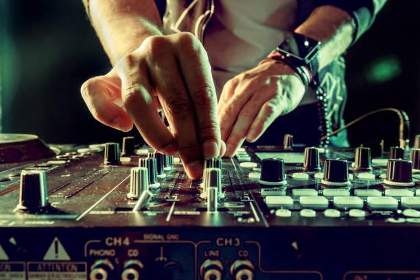 DJ playing music at mixer closeup DJ playing music at mixer closeup dj stock pictures, royalty-free photos & images