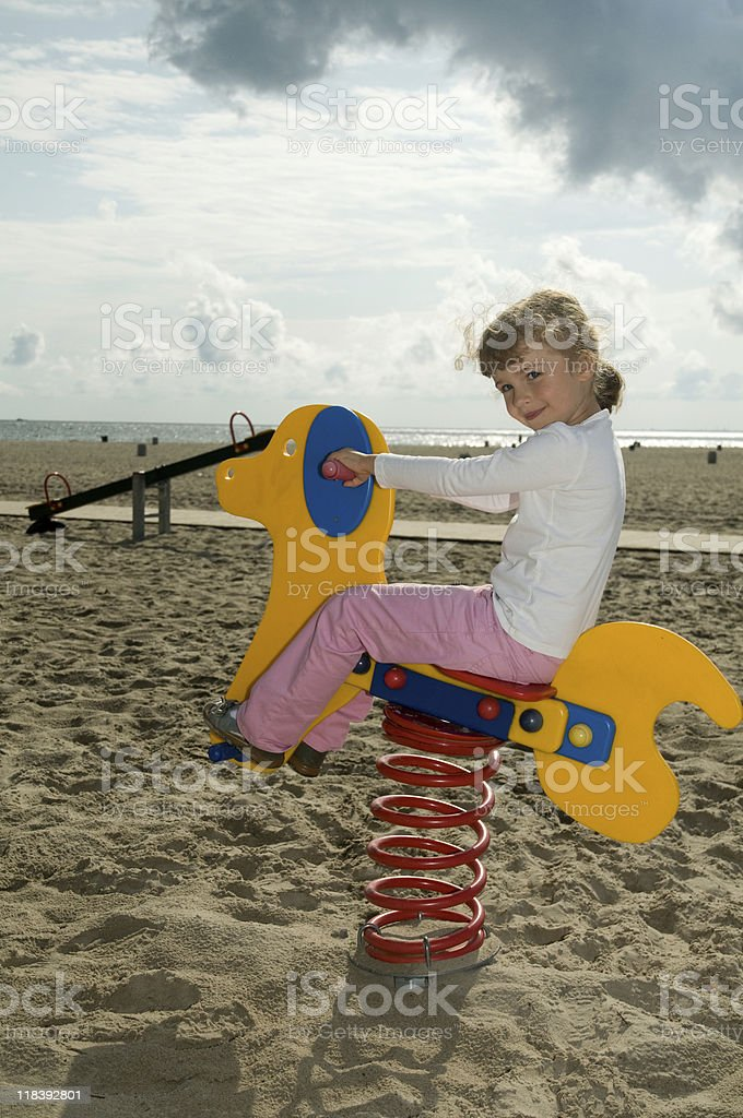 Playing on a teeter totter stock photo