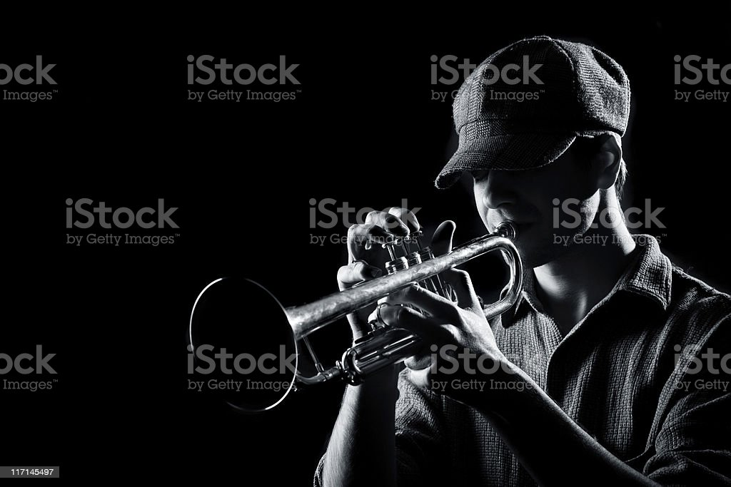 Playing on a trumpet stock photo