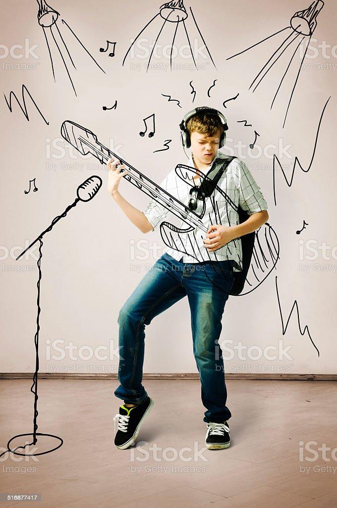 playing on drawn guitar stock photo