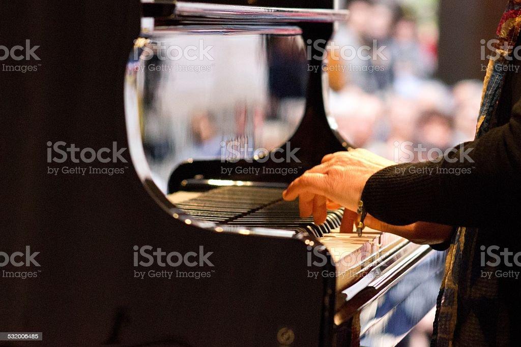 Playing on piano keyboard stock photo