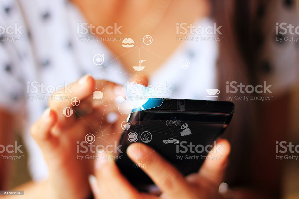Playing on smartphone stock photo