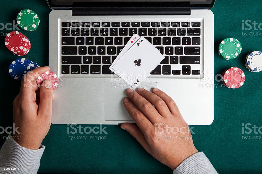 Playing Online Poker with Laptop , Top View stock photo