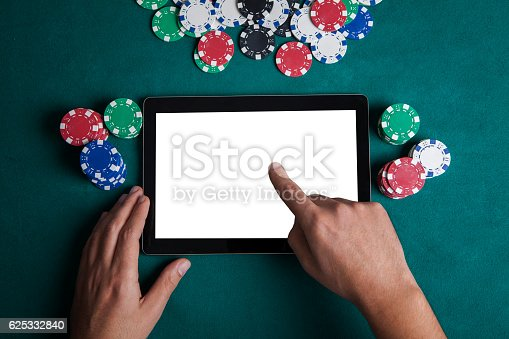 istock Playing Online Poker with Tablet , Top View 625332840
