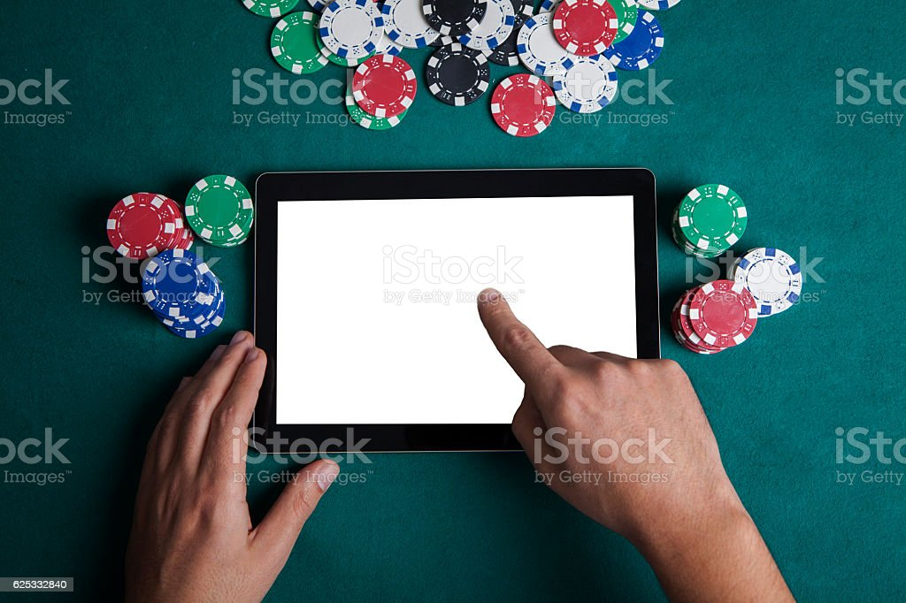 Playing Online Poker with Tablet , Top View stock photo