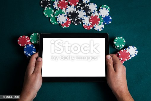 istock Playing Online Poker with Tablet , Top View 625332996