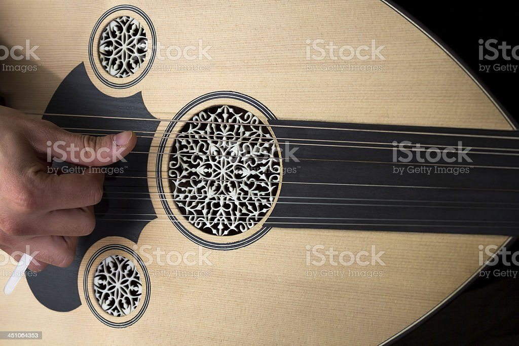 Playing Oud stock photo
