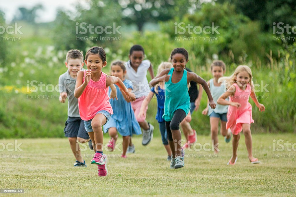Playing Outside in a Field on a Sunny Day - foto stock