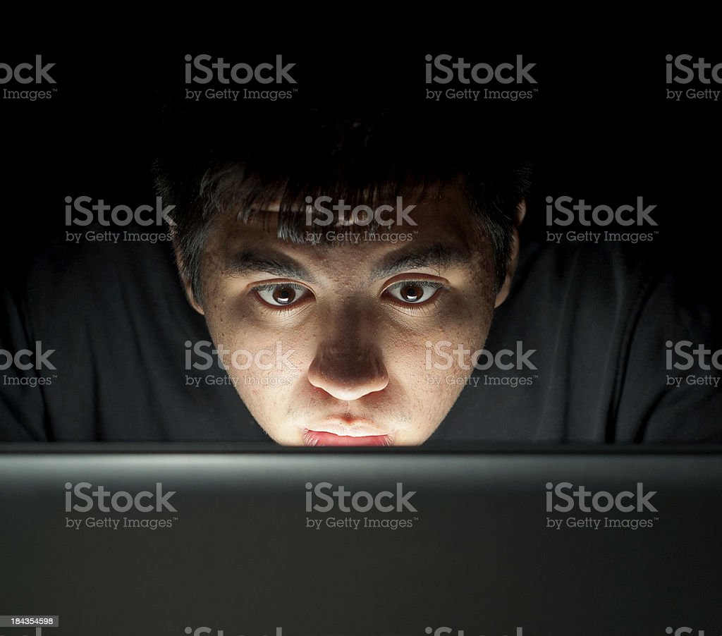 Playing PC Game on Laptop at Late Night stock photo