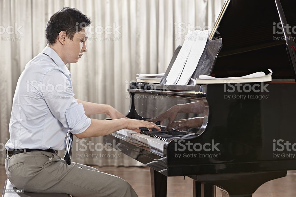 Playing piano royalty-free stock photo