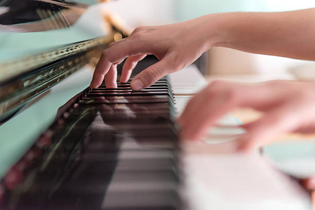 Playing Piano (Soft Focus) Playing Piano (Soft Focus) pianist stock pictures, royalty-free photos & images
