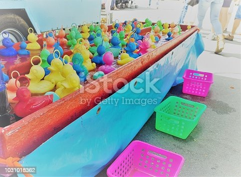 Playing plastic colorful ducklings on a fairground party
