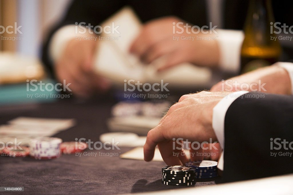 Playing poker at table gambling stock photo