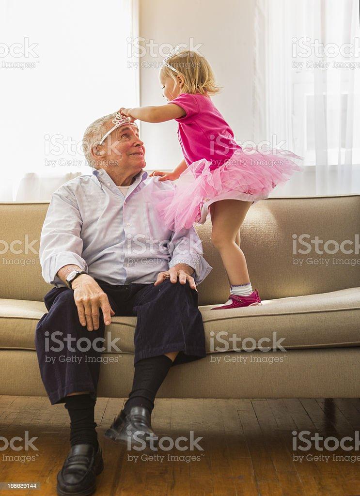 Playing princess with Grandpa stock photo