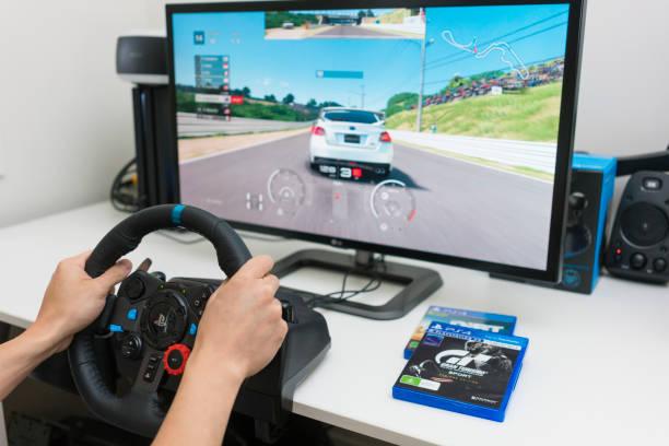 afspelen van video racespel thuis - playstation stockfoto's en -beelden