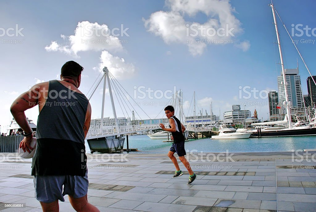 Playing Rugby against an Urban Auckland Scene, New Zealand stock photo