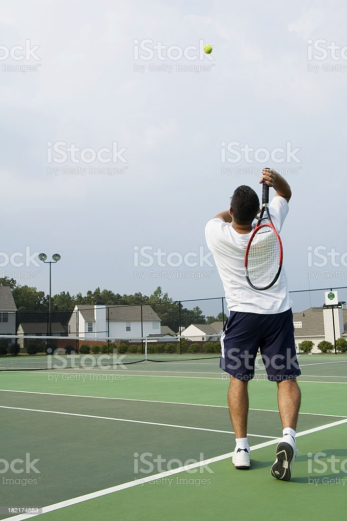 playing singles tennis royalty-free stock photo