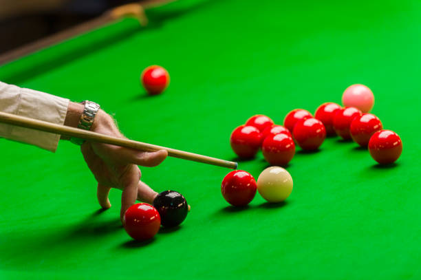 playing snooker - man aiming the cue ball stock photo