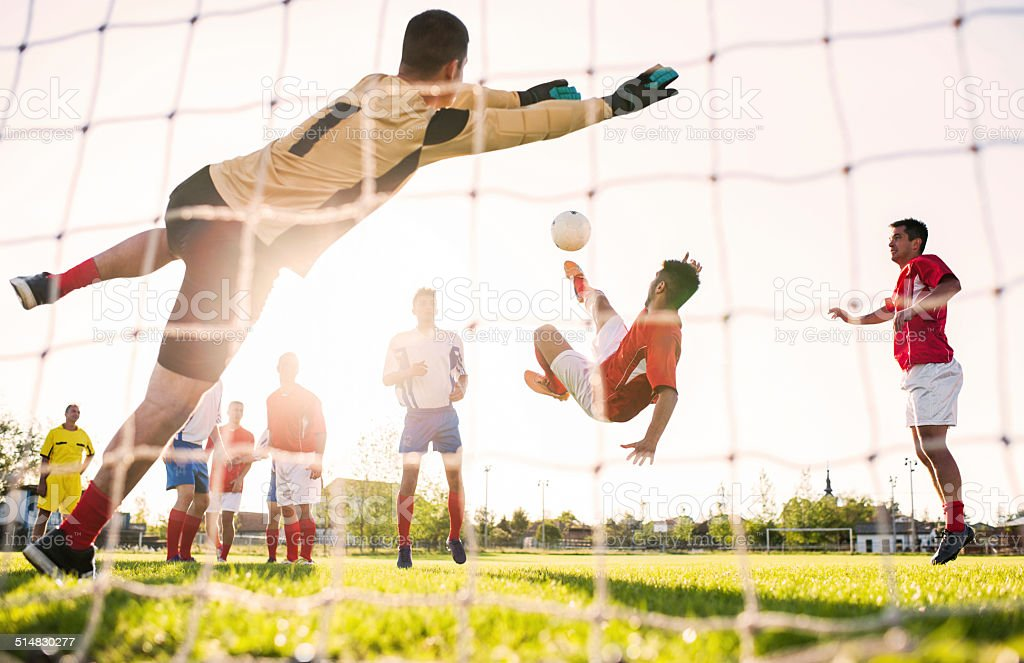 Playing soccer at sunset. stock photo